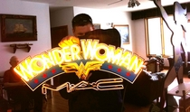 MAC Wonder Woman makeup display neon sign at the Marston family Wonder Woman Museum with Will Holland, granson of William Moulton Marston