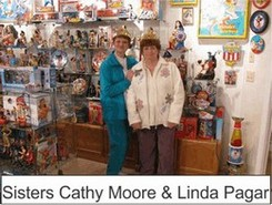 Sisters Cathy Moore And Linda Pagar in the Marston Family Wonder Woman Museum